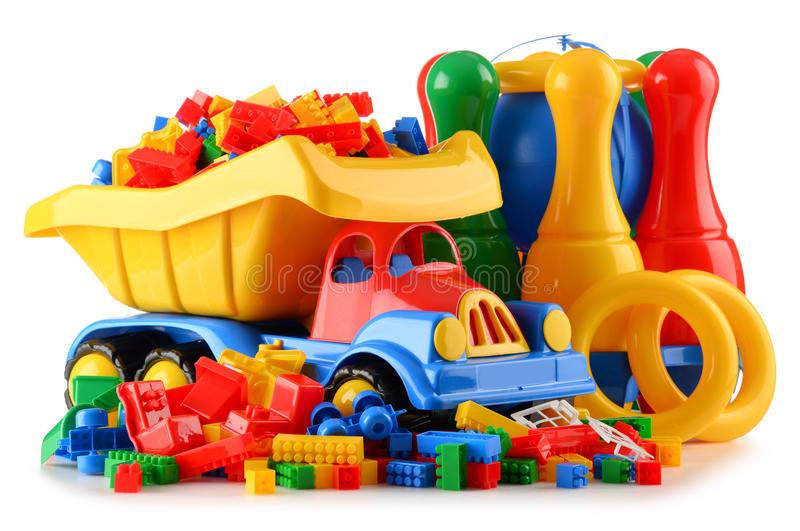 Colorful plastic children toys on white background stock photos