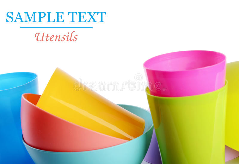 Colorful plastic cups and plates royalty free stock images