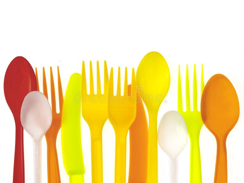 Colorful plastic cutlery isolated on white background, as EU parliament votes to ban single-use plastic items. royalty free stock photography