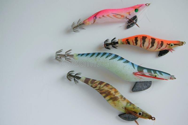 colorful plastic fishing baits on white background, space for text royalty free stock photo