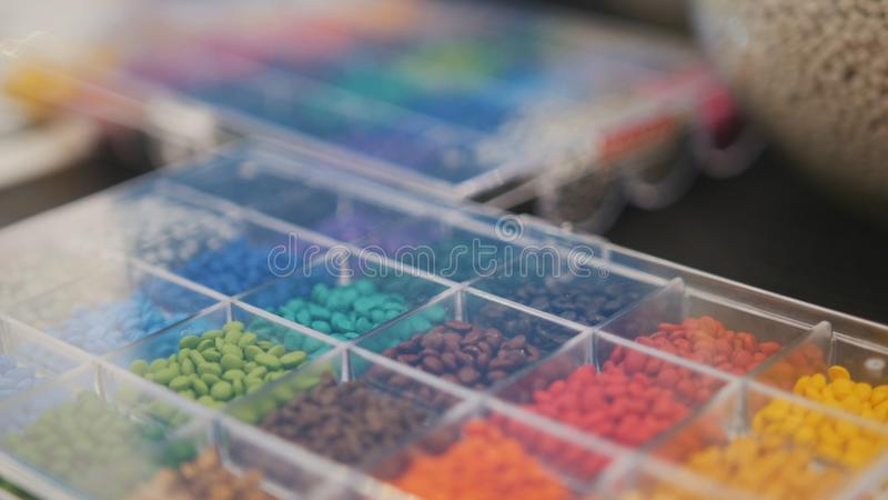 Colorful plastic granules on extruder for making plastics on extrusion manufactory. Close up royalty free stock image