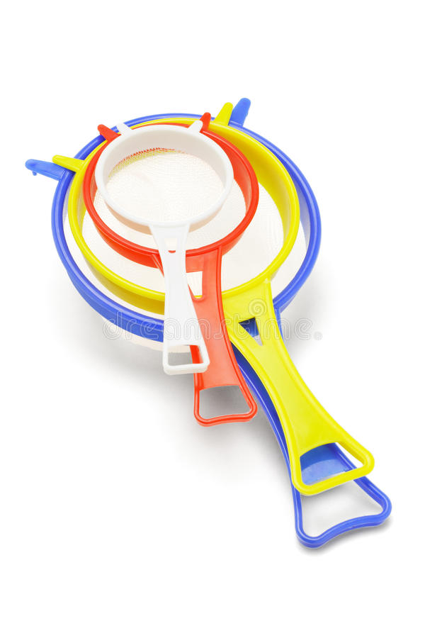Plastic Kitchen Sieves. Colorful Plastic Kitchen Sieves on White Background stock photography