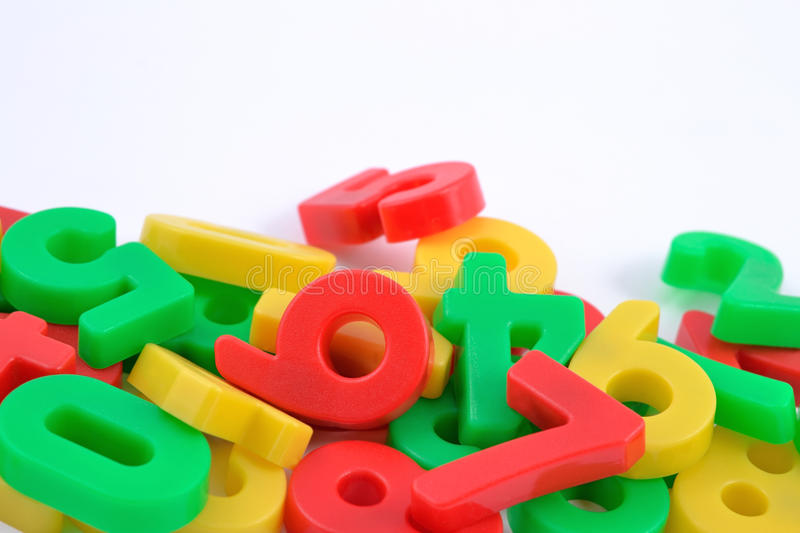Colorful plastic numbers on white. Background royalty free stock photography