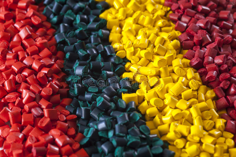 Colorful plastic polymer granules. Bunch of colorful plastic masterbatch polymer granules royalty free stock images