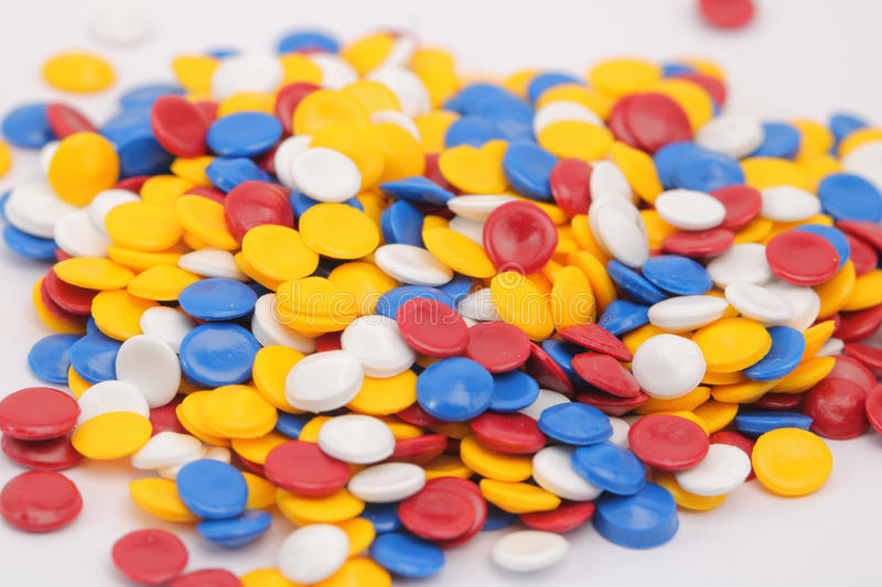 Colorful plastic polymer. Granules on white royalty free stock images