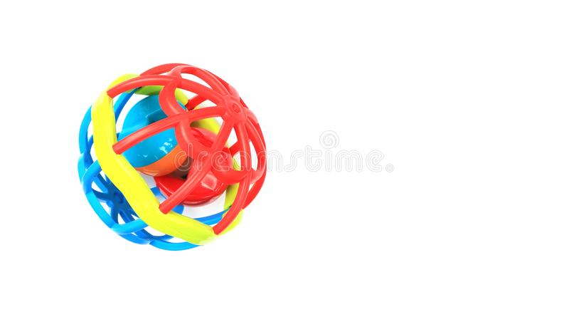 Colorful plastic rattle ball for developing motor skills. Isolated on the white background royalty free stock images