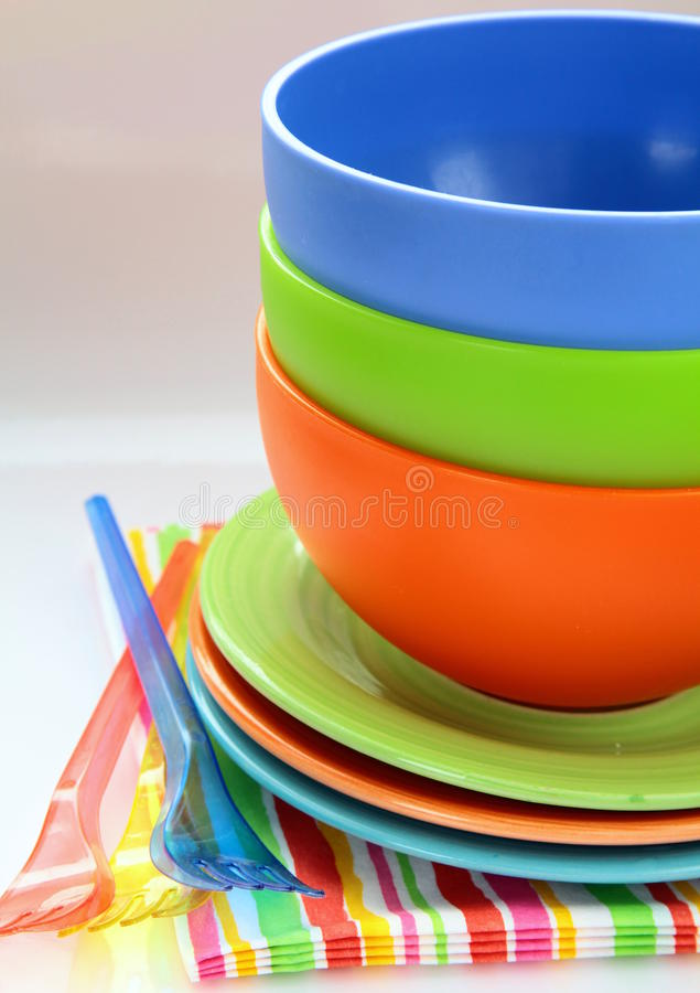 Colorful plastic tableware and napkins stock photo