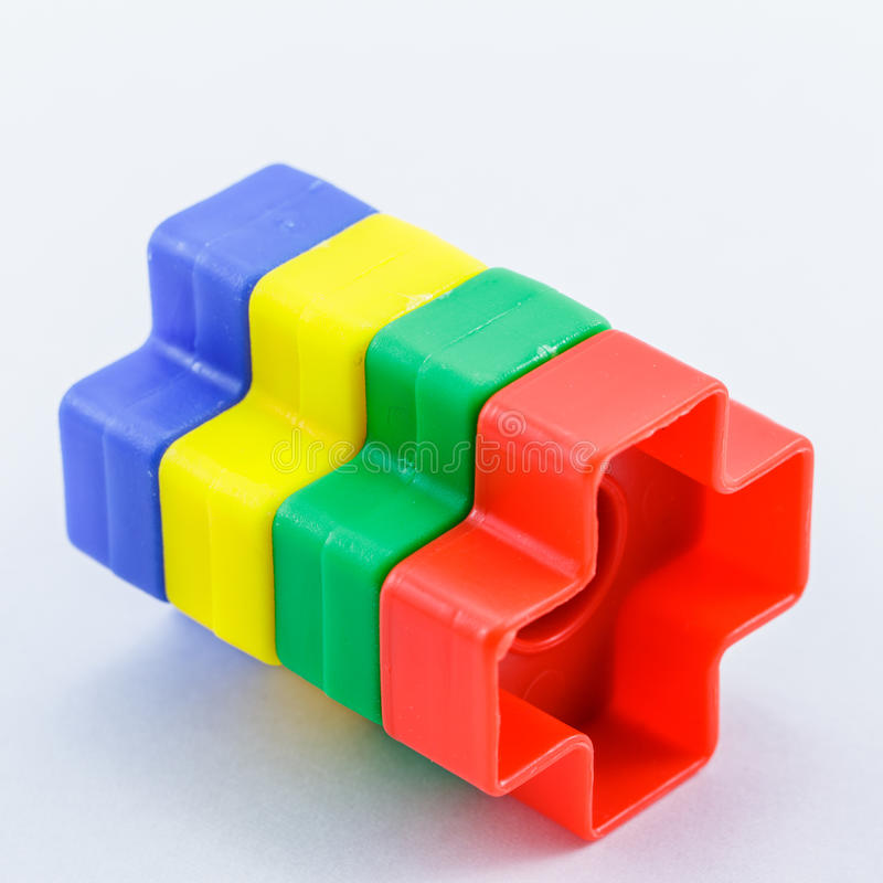 Colorful plastic toy. Bolts and nuts on a white background stock photography