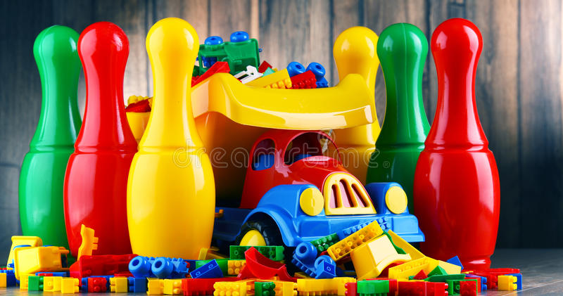 Colorful plastic toys in childrens room.  stock photo