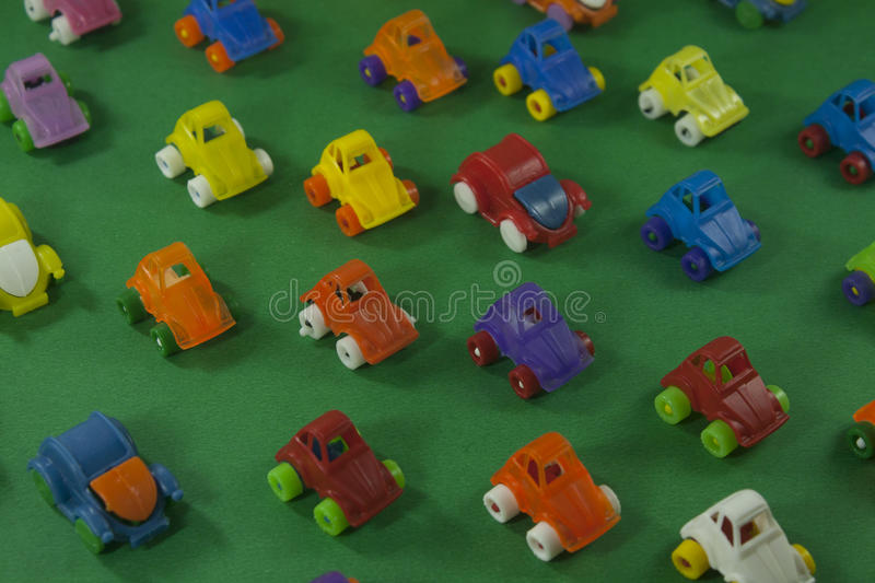 Colorful plastic toys. On a green background stock images