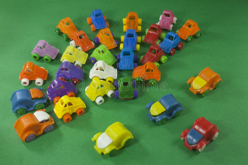Colorful plastic toys. On a green background stock photo