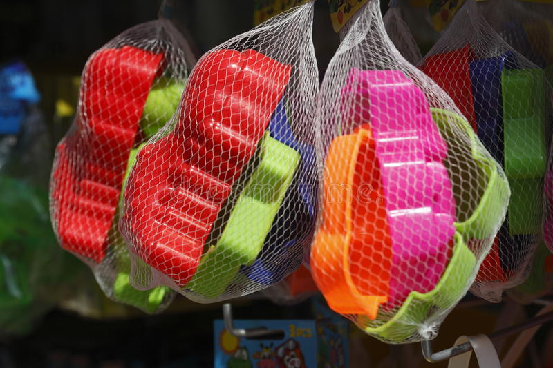 Colorful plastic toys. In a net at ashop royalty free stock photography