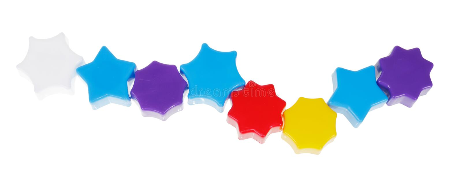 Colorful plastic toys. Set of colorful plastic construction toys isolated on white background royalty free stock images