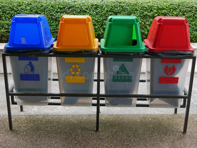 Colorful plastic trash bins / cans for waste separation. Four colorful plastic trash bins / cans for waste separation royalty free stock image