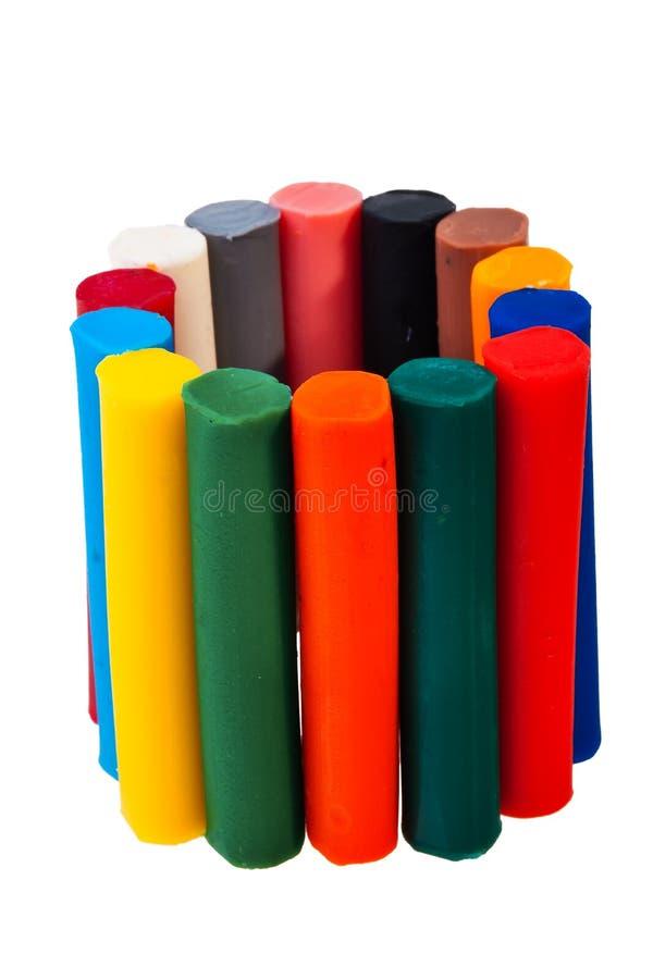 Colorful plasticine bars. Colorful plasticine bars over white background royalty free stock photos