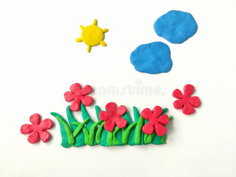 Colorful plasticine clay, red flower grasses sun cloud dough, beautiful nature royalty free stock images