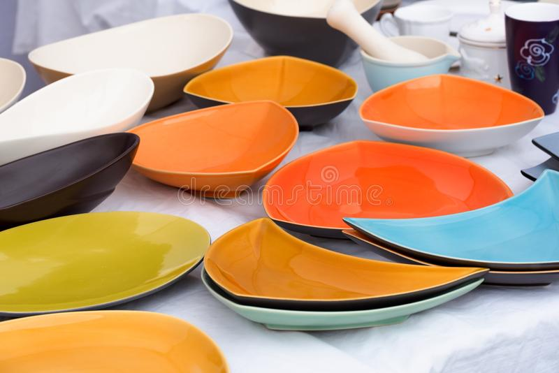 Colorful plates and bowls for sale at a local market. Variety of colorful ceramic bowls and plates for sale at a local market in Palanga, Lithuania stock images