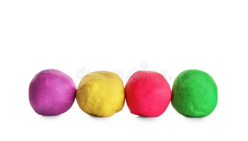 Colorful play dough. On white background stock image
