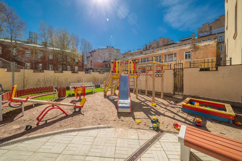 Colorful playground equipment. For children in public yard in summer stock image