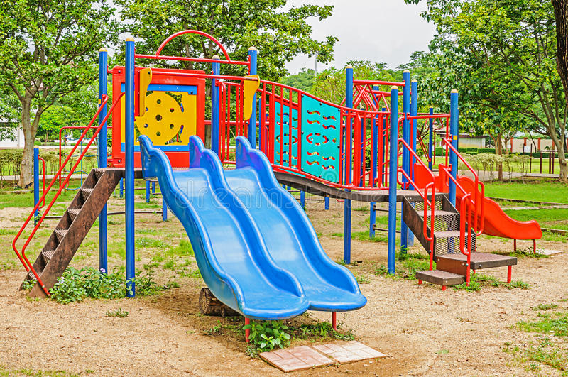 Colorful playground equipment. In the public park stock photos