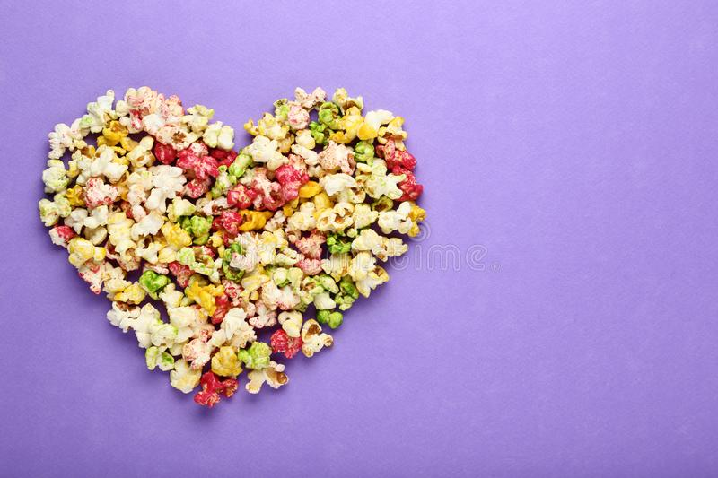 Popcorn in heart shape stock photos