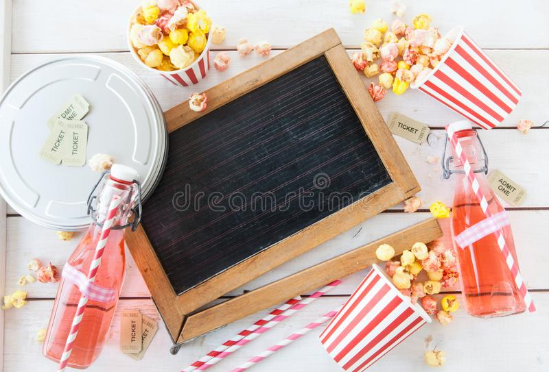 Colorful popcorn in striped cups stock image