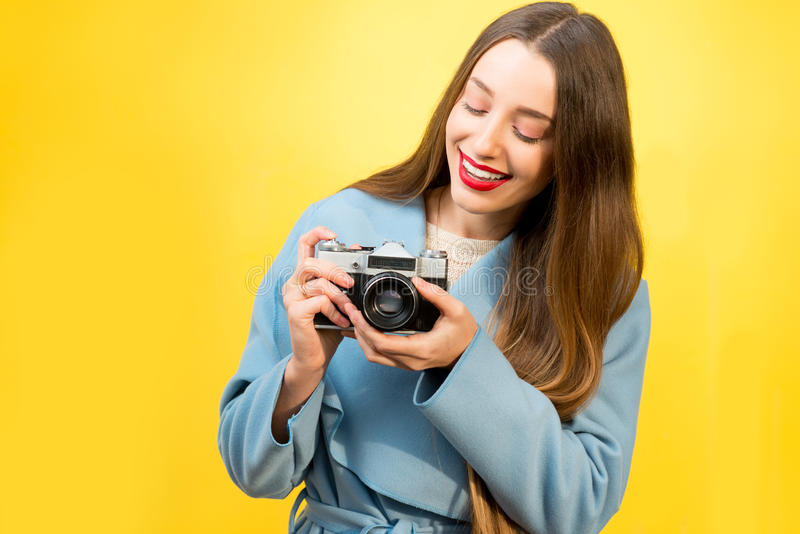 Colorful portrait of the female photographer royalty free stock photography