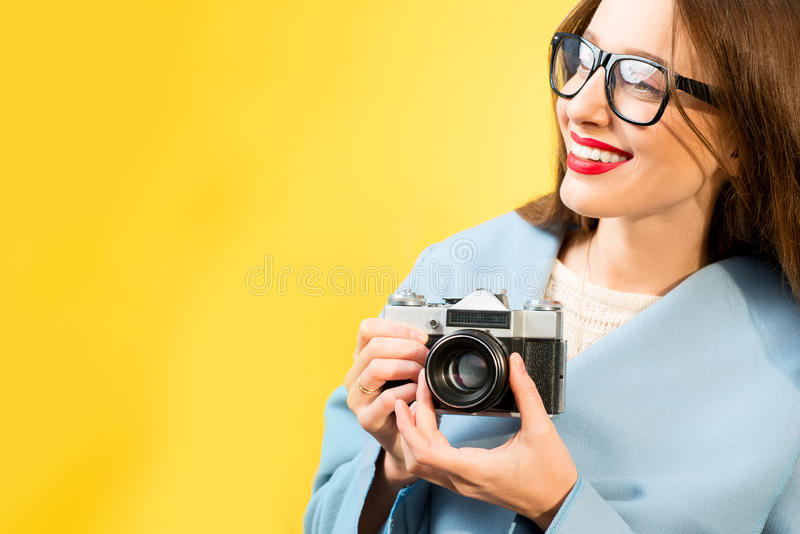 Colorful portrait of the female photographer stock image