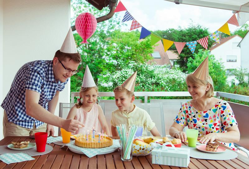 Colorful portrait of happy family celebrate birthday and grandpa stock photography