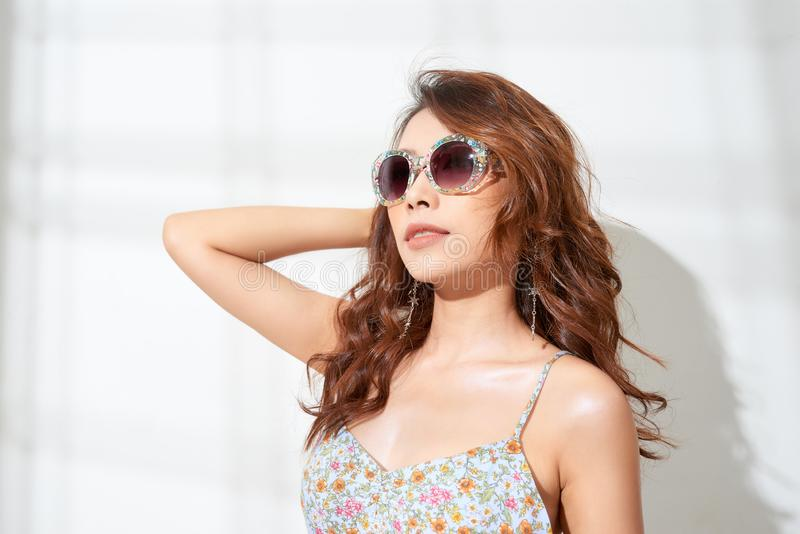 Colorful portrait of young attractive woman wearing sunglasses. Summer beauty concept royalty free stock photo