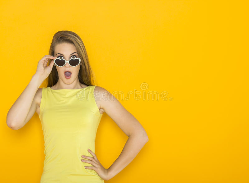 Colorful portrait of young attractive woman wearing sunglasses. Summer beauty concept royalty free stock images