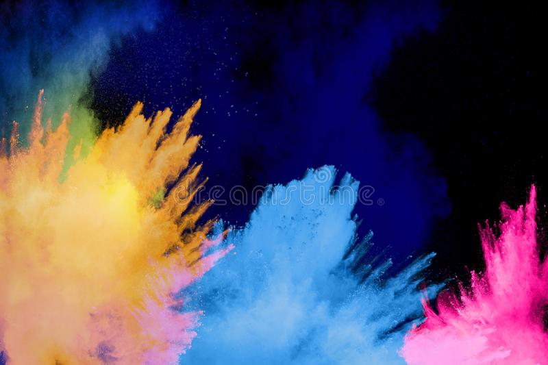 Colorful powder explosion cloud on black background. Freeze motion of color dust  particles splash royalty free stock photography