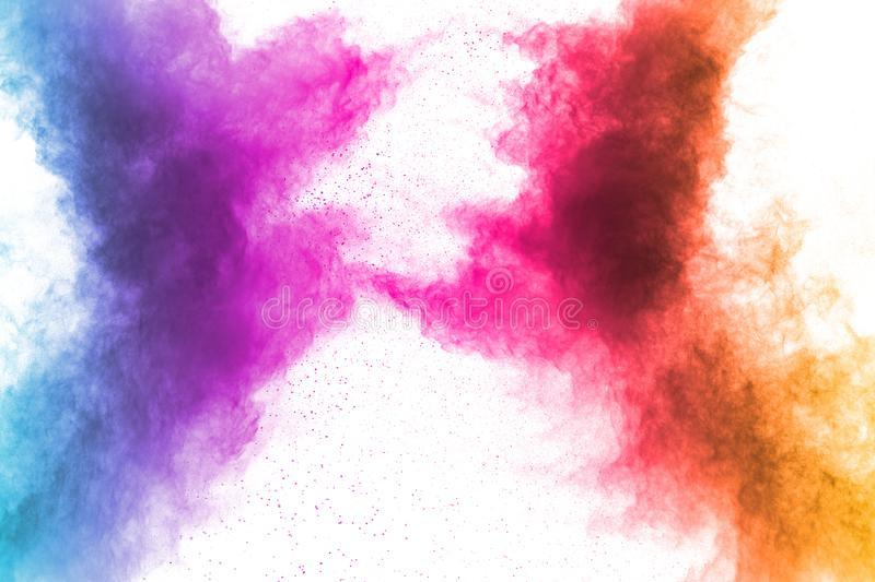 Colorful powder explosion on white background. Abstract pastel color dust particles splash.  stock images