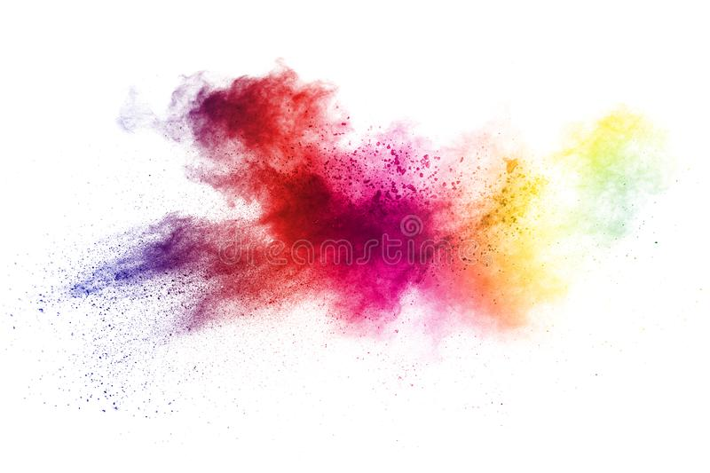 Colorful powder explosion on white background. Abstract pastel color dust particles splash royalty free stock images
