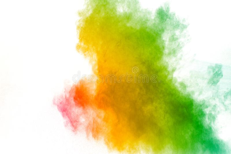 Colorful powder explosion on white background. Abstract pastel color dust particles splash.  royalty free stock image