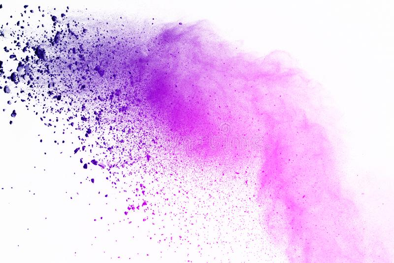 Colorful of powder explosion on white background. Blue and purple powder explode on isolate background. Paint Holi. Colorful stock image