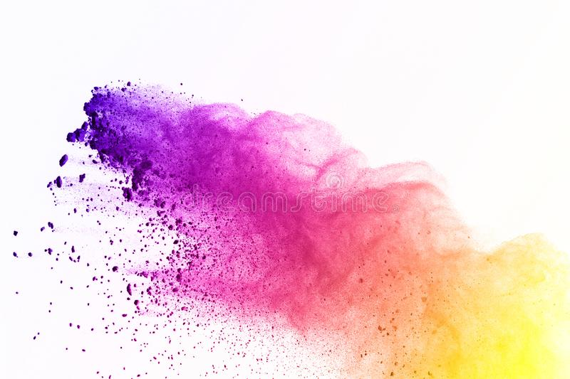 Colorful of powder explosion on white background. Green and yellow dust explode on isolate background. Paint Holi. Colorful cloud royalty free stock photo