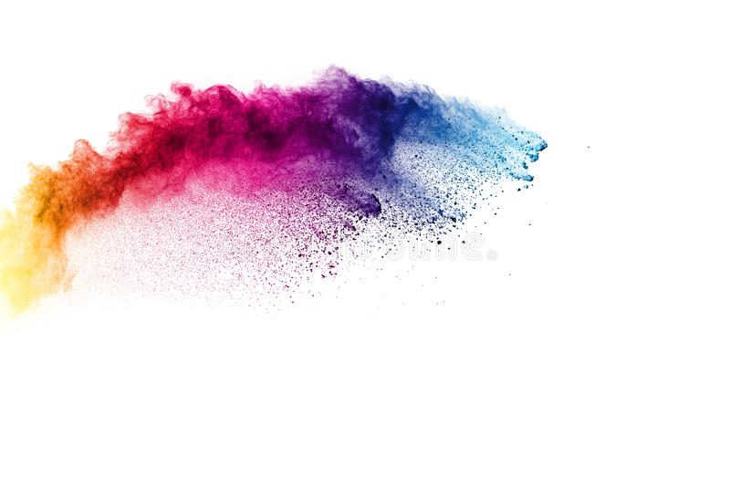 Colorful powder explosion on white background. Pastel color dust particle splashing.  stock photos