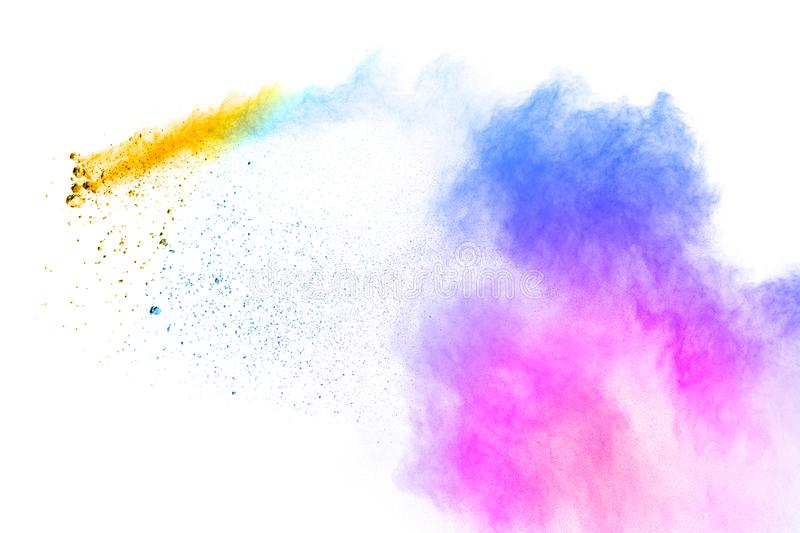 Colorful powder explosion on white background. Pastel color dust particle splashing.  stock images