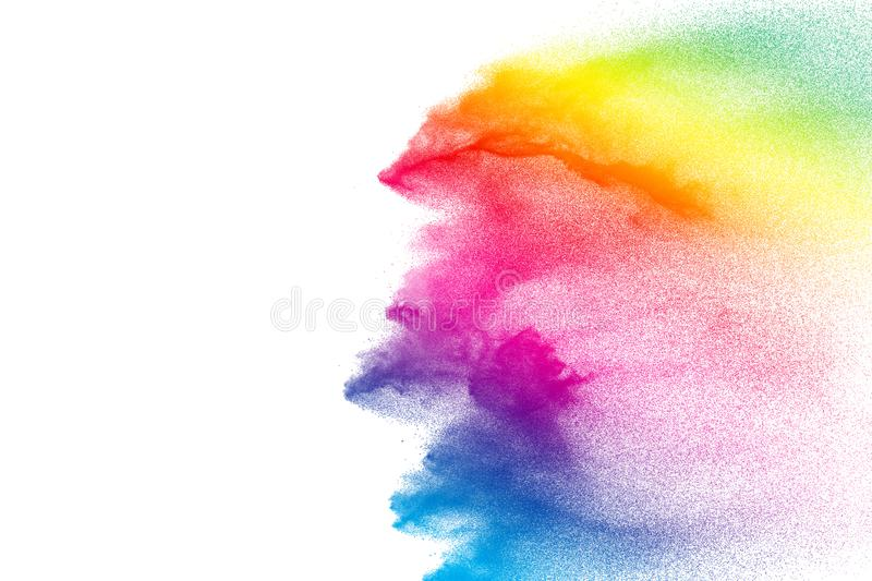 Colorful powder explosion on white background. Pastel color dust particle splashing.  royalty free stock images
