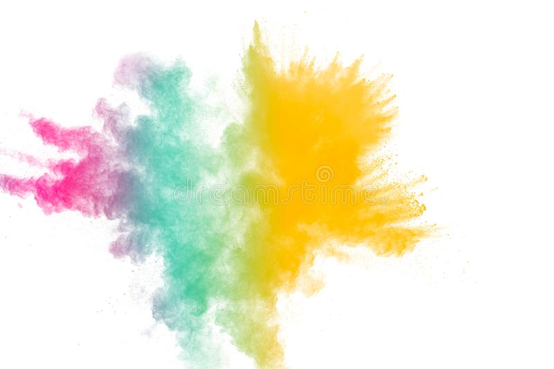 Colorful powder explosion on white background.Pastel color dust particle splashing.  royalty free stock photography