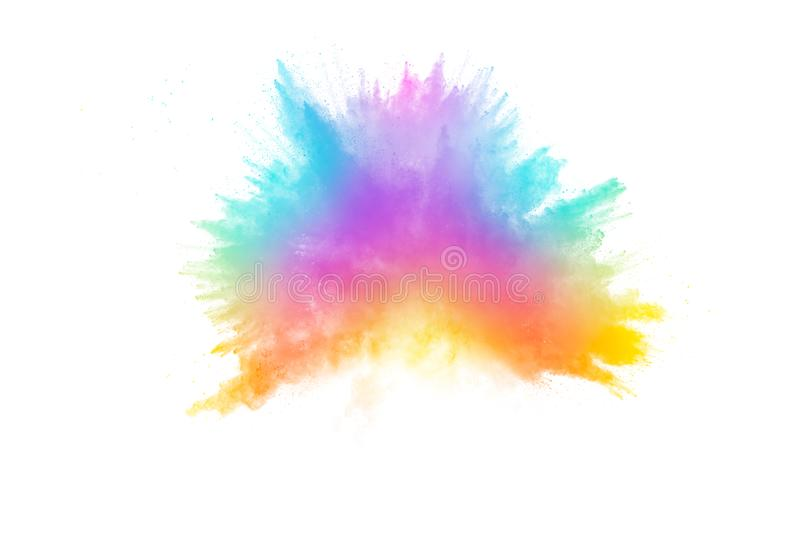 Colorful powder explosion on white background.Pastel color dust particle splashing.  stock images