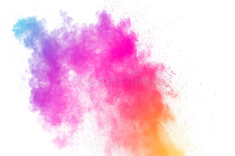 Colorful powder explosion on white background.Pastel color dust particle splashing.  royalty free stock photo