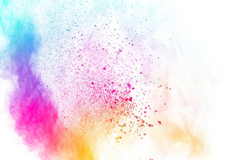 Colorful powder explosion on white background.Pastel color dust particle splashing.  royalty free stock images