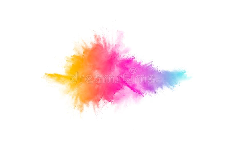 Colorful powder explosion on white background.Pastel color dust particle splashing.  stock photo