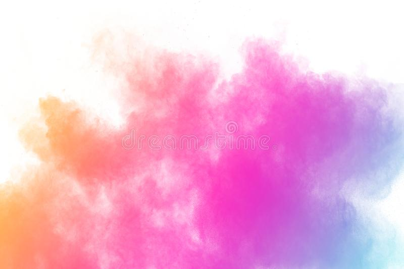 Colorful powder explosion on white background.Pastel color dust particle splashing.  royalty free stock photos