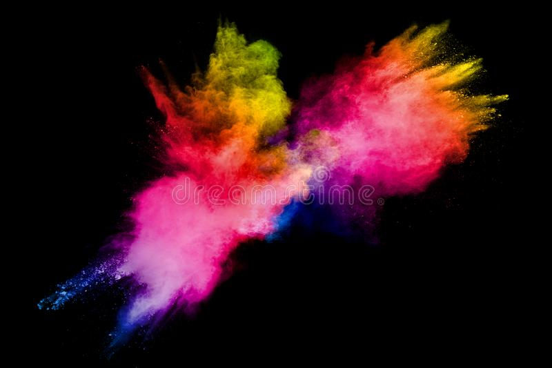 Colorful powder explosion on white background.Pastel color dust particle splashing.  stock image