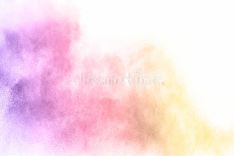 Colorful powder explosion on white background. Pastel color dust particle splashing.  royalty free stock photos