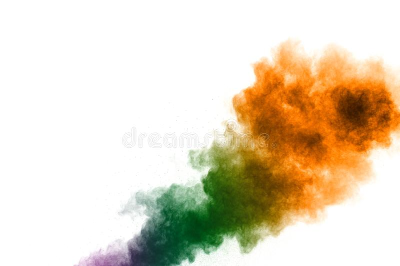 Colorful powder explosion on white background.Pastel color dust particle splashing. Colorful powder explosion on white background.Pastel color dust particle stock photos