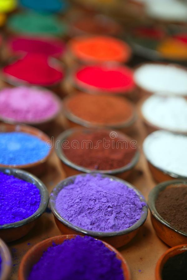 Colorful powder pigments in rows stock images